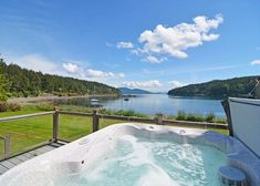 Orcas Island, #sanjuanislands vacation rental beach house has 200' of private, no bank, pebble/sand water frontage plus a mooring buoy. Also mountain views, a hot tub, cozy island charm & modern comforts for the whole family to enjoy. #travel