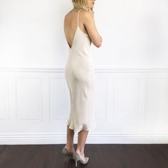 <p>Simply chic cream silk slip dress! Fully lined lightweight beautiful draping silk dress with v-neckline ...