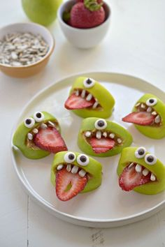 "Silly Apple Bites:   INGREDIENTS  2 green apples, each quartered  sunflower butter  32 sunflower seeds  2-3 strawberries, sliced  1-2 homemade googly eyes per apple bite. Cut the middles out of each quarter of the apple to create a mouth.  Coat the inside of the cut gap with a filling of sunflower butter.  Place 4 sunflower seeds the top of the ""mouth"" for the teeth.  Place 1 sliced strawberry for the tongue.  ""Glue"" each eye above the mouth with a dab of sunbutter. By: Recipes Galore"