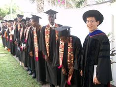 Kentaro Toyama, right, and the first graduates of Ashesi University in Ghana, which was started by a former Microsoft engineer. Toyama taught calculus during the school's first year in 2002.  (Public Affairs)