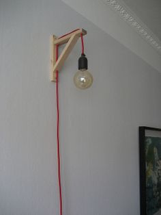 Johan Lindberg. #diy hanging light. looks like bulb threaded through an ikea shelf bracket.