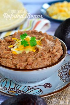 Easy and delicious Slow Cooker Refried Beans (without the refry!) Perfect for Cinco de Mayo or your next Mexican fiesta! | MomOnTimeout.com
