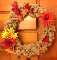 """DIY burlap wreath--pretty easy and pretty cheap! Materials: wire frame, roll of burlap,  seasonal decorations (could be good for Christmas too!)                                            Instructions:  Weave the burlap under-over-under-over on the wire frame. Scrunch the burlap together, making sure to pull on the """"over"""" so that the burlap is loose and has a fluffy look. Secure ends with picture wire if necessary, and then decorate!"""
