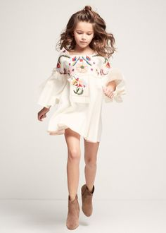 Embroidered bell sleeve dress with tassel detail. 100% Cotton