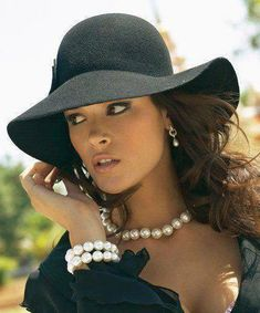I'm in love with pearls. At least wear glass or real pearls if you're up dressing. The  fakes look like you childhood dress up junk. The hat is a nice touch, but in the day time wear straw with a black ribbon. Save the bonnet for a funeral or formal affair involving the Royals.