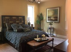 Teal brown and yellow bedroom designed by Classic Furniture for the Parade of Homes 2014