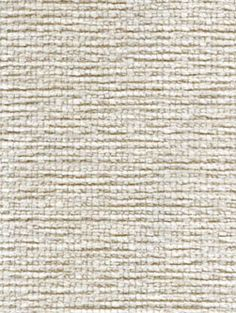 Aramis in Cream offers an American-made residential upholstery fabric featuring a deep, plush pile of cut cotton chenille in a pleasing shade of white nuanced with natural undertones.