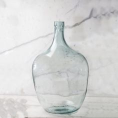 etúHOME's recycled glass demijohn hints at its rich history. Mouth-blown and handcrafted, these vintage glass containers retain their original character. Large Glass Vase, Glass Bottles, Clear Glass, Painted Fox Home, Long Stem Flowers, Fiddle Fig, The Originals Characters, Fig Leaves, Tiny House Design