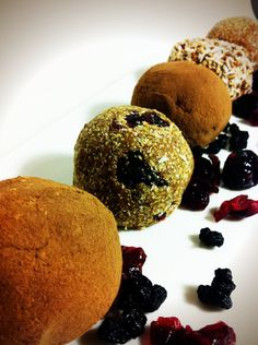 Cherry Pie Protein Balls  Ingredients:  2 Cups of Pecans  1 Cup of Pitted Dates  3 Scoops of Protein Powder  1 Tbsp Vanilla Extract  ¼ Cup Ground Flax (optional)  Juice of 1/2 Lemon  Zest of 1/2 Lemon  ¼ Cup Water  1/3 Cup Dried Natural Cherries  1/4 Cup Toasted Coconut (for rolling)