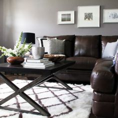 Modern Rustic Living Room - Grey walls, dark brown furniture, & bright colors for accent. Living Room Color Schemes, Living Room Colors, Living Room Paint, Living Room Designs, Living Rooms, Colour Schemes, Color Palettes, Brown Couch Living Room, Brown Sofa Grey Walls