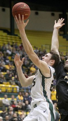 William & Mary's Terry Tarpey gets the shot past Towson's Alex Gavrilovic during the second half Wednesday at W&M. (Photo by Rob Ostermaier / Daily Press)