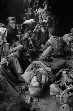 US soldiers relax on the long boat trip back to their base camp after a day trudging through the coconut groves of Kien Hoa province. Photograph: Henri Huet/AP