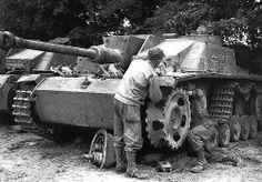 Germans repairing the drive wheel & track on a Stugg-Sturmgeschütz 75mm Stu.K. 40 Ausf. G (Sd.Kfz. 142/1) Nr. 232.