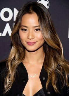 Jamie Chung embraces the dark to light contrast, but updates sandy, pale, and blonde shades to honey and caramel.