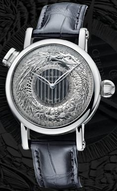 Chronoswiss Ouroboros for ONLY WATCH 2015 - Dating back to ancient Egypt, mankind has always been fascinated by the Ouroboros, a motif depicting a serpent eating its own tail and a symbol of self-reflexivity and the eternal re-creation process. Set in a 40 mm case made of solid white gold, the Ouroboros has been engraved by hand into a solid white gold dial. The three-dimensional serpent offers a beautiful coating of patina. After the snake has been engraved, the artisan still has to perform…