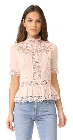 short sleeve eyelet top by Rebecca Taylor. Lace insets and tonal embroidery bring romantic style to this lightweight Rebecca Taylor blouse. Scalloped edges crea...