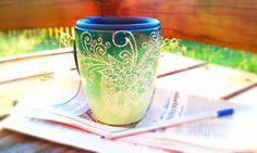 Teal ombre mug with white henna swirl flower design (black lid included).