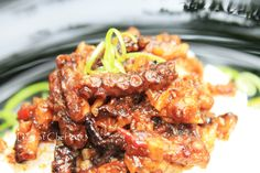 Octopus with spicy chilli and garlic sauce is one of easy and tasty octopus recipe. Octopus  had been a used for human consumtions from centuries ago in many cultures.  Whole octopus are edible, bu…