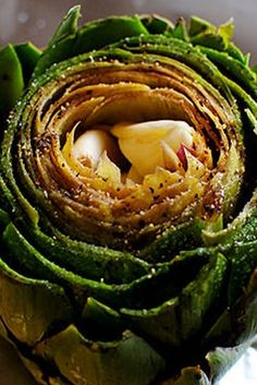 Roasted artichoke stuffed with garlic cloves for a burst of flavor.