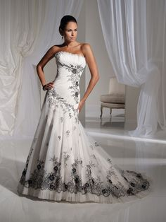 White gown black applique and beading.