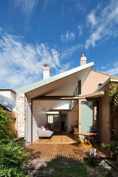 Adriano Pupilli Architects has designed a Courtyard House in Sydney's Petersham that fits its charming design snuggly between terrace houses.