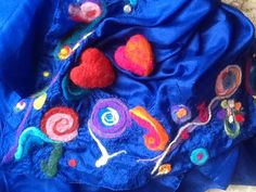 Needle felted hearts on felted silk scarf