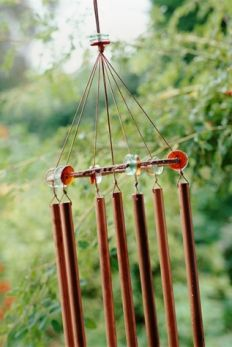 Reuse copper pipes to make wind chimes by cutting various lengths of tube, drilling a hole an inch from their tops, and hanging them from a wood disc with  fishing line.