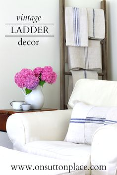 Antique grain sacks placed on a vintage ladder...what a great way to use heirloom linens in your decor!