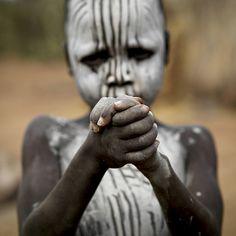 Mursi kid - Ethiopia ©  Eric Lafforgue, via Flickr