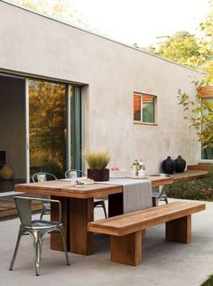 clean lines, simple and stylish outdoor terrace with table and benches- makes a huge difference / imagine the pic with out the tables and benches -___-