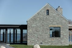 """Imagining a second home as a cottage retreat gave the team the creative opportunity to """"think about how you want to live in comparison to how you're living,"""" says Adair. Cottage Exterior, Modern Farmhouse Exterior, Gros Morne, Rural House, Irish Cottage, Modern Barn, Cottage Design, Stone Houses, Exterior Design"""