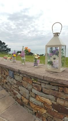 Lanterns filled with flowers- sweet rustic and natural