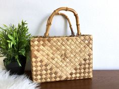 Vintage bamboo handle woven straw handbag - Beautiful bamboo handle - Nice fabric lining - One zipping center pocket - 2 main pockets  Measures: 10 long x 8 tall x 4 deep bag (+4.5 w handles)  CONDITION REFERENCE CHART RATING: Excellent Extremely minimal wear for its age. Gorgeous bag.  Thanks for looking and check out my other listings at: https://www.etsy.com/shop/RachaelsRealm?ref=hdr_shop_menu  RACHAELS GIVES 10% TO A LOCAL NONPROFIT. More information available i...