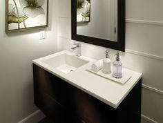 transitional bathroom by MTI Baths- offset counter and paneled horizontal lined walls