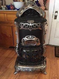 Antique heaters wood burning stoves antique stoves Propane stove left on overnight