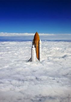 Space shuttle rising through the clouds.