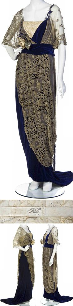 Evening gown, Worth, ca. 1910. Cobalt blue silk velvet underdress with a peach velvet inset to the V-neckline and gold lace and net overlay. Velvet cummerbund and silk flower embellishment at the bust, lightly boned, with a small weighted hem train.