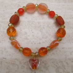 VALENTINE'S SPECIAL Orange beaded bracelet with lampwork heart charm (Normally GBP 7.00) by PreziosoJewellery on Etsy