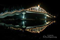 The bridge from the ashram over the backwaters to Vallikavu near Amritapuri, India.