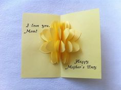 Cute handmade 3D card idea for Mother's Day. When you open this greeting card - the paper flower pops up!. It's a pretty unique card! Here's how. Materials paper glue scissors