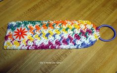~ Dly's Hooks and Yarns ~: ~ hot or cold drink cozy ~     This is her pattern using an elastic hair band and a button. When finished the cotton crocheted cozy can be rolled up and put in your purse.