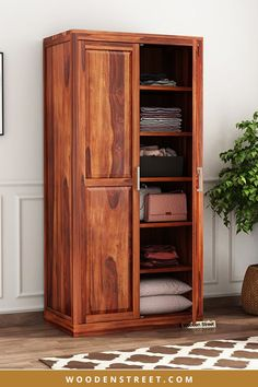Nixon is a subtle yet contemporary furniture design that can fit with every interior decor. It is a two-door wardrobe which is further segmented with four panels upon the doors. It has numerous shelves of different sizes inside it. This furniture is made out of Sheesham wood. It has three finish options of honey, teak and walnut available with it. Bedroom Furniture, Furniture Design, Wooden Street, Contemporary Furniture, Teak, Interior Decorating, It Is Finished, Shelves, Doors