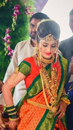 Vibrant Orange and Green Nauvari Saree with Traditional Gold Jewelry on a Beautiful Marathi Bride