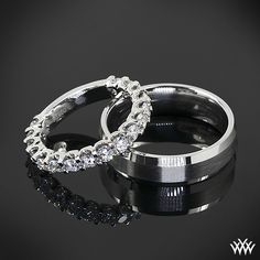 """Gorgeous couple - This """"Annette's U-Prong"""" ¾ Diamond Wedding Ring is set in platinum and holds gorgeous A CUT ABOVE® Hearts and Arrows Diamond Melee. Then we have a """"Mirror Edge"""" Wedding Ring by Benchmark that is also set in platinum."""