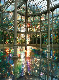 PalacIo de Cristal, Madrid - Spain - Kimsooja (b. Taegu, Korea, 1957, South Korean) - A Reflective Palace Of Rainbows, 2006   The Palacio de Cristal was originally built in the late 1880s in Madrid, Spain. In 2006 artist Kimsooja transformed it into this rainbow reflecting palace.