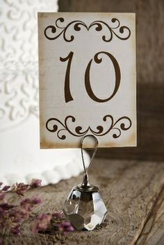 save on crafts ...love the holder.......Handmade Scroll Table Numbers (1-15)