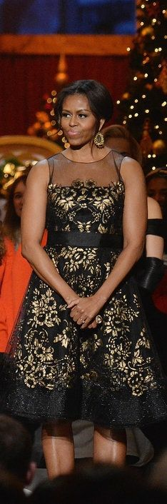 Michelle Obama's ornate black and gold dress at the Christmas celebration.