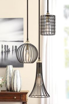Light up the room with a chandelier that makes a serious style statement. Edison light bulbs are surrounded by distressed black iron, creating a look that's vintage-inspired yet so contemporary. The three pendants make up one chandelier that will look stunning over a rustic dining table.