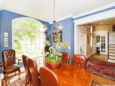 Beautiful dining room with large picture window and blue walls