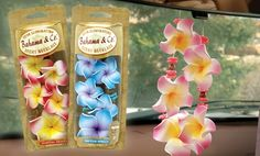Four colorful air fresheners in lei-inspired necklace designs fill cars with soothing scents such as Tropical Breeze and Tahitian Vanilla